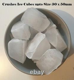 A Commercial Electric ice crusher, shaver, slush or snow cone ice machine KCICL